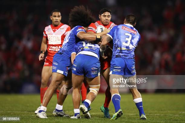 Jason Taumalolo of Tonga is tackled by the Samoan defence during the 2018 Pacific Test Invitational match between Tonga and Samoa at Campbelltown...