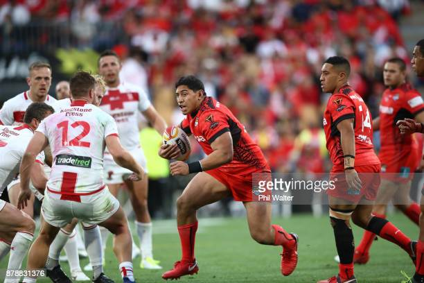 Jason Taumalolo of Tonga is tackled during the 2017 Rugby League World Cup Semi Final match between Tonga and England at Mt Smart Stadium on November...