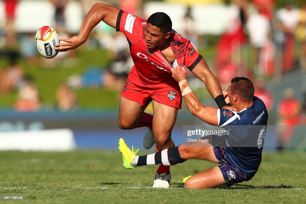 Jason Taumalolo of Tonga passes during the 2017 Rugby League World Cup match between Scotland and Tonga at Barlow Park on October 29, 2017 in Cairns, Australia.