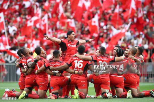 Jason Taumalolo of Tonga performs the cultural challenge during the 2017 Rugby League World Cup Semi Final match between Tonga and England at Mt...