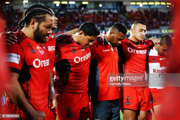 Jason Taumalolo of Tonga prays with the team after losing the 2017 Rugby League World Cup Semi Final match between Tonga and England at Mt Smart...
