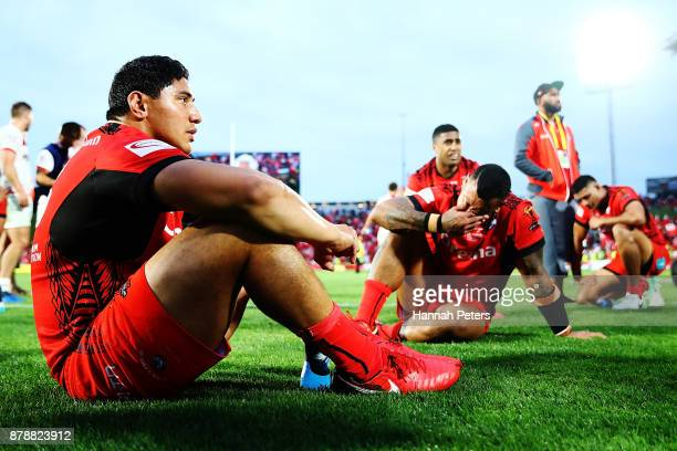Jason Taumalolo of Tonga sits with his team after losing the 2017 Rugby League World Cup Semi Final match between Tonga and England at Mt Smart...