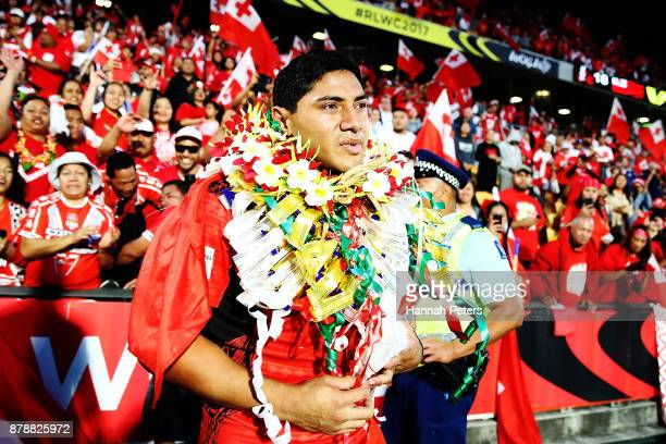 Jason Taumalolo of Tonga visits his family in the crowd after losing the 2017 Rugby League World Cup Semi Final match between Tonga and England at Mt...