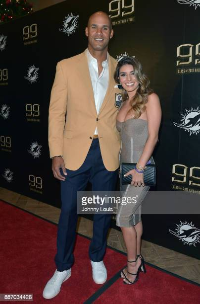 Jason Taylor and Monica Velasco attend The Miami Dolphins 'Hall of Fame Celebration' hosting Jason Taylor at Hard Rock Stadium on December 02 2017 in...