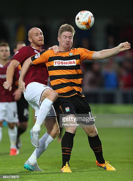 Jason Taylor of Northampton Town contests the ball with Michael Gash of Barnet during the Sky Bet League Two match between Barnet and Northampton...