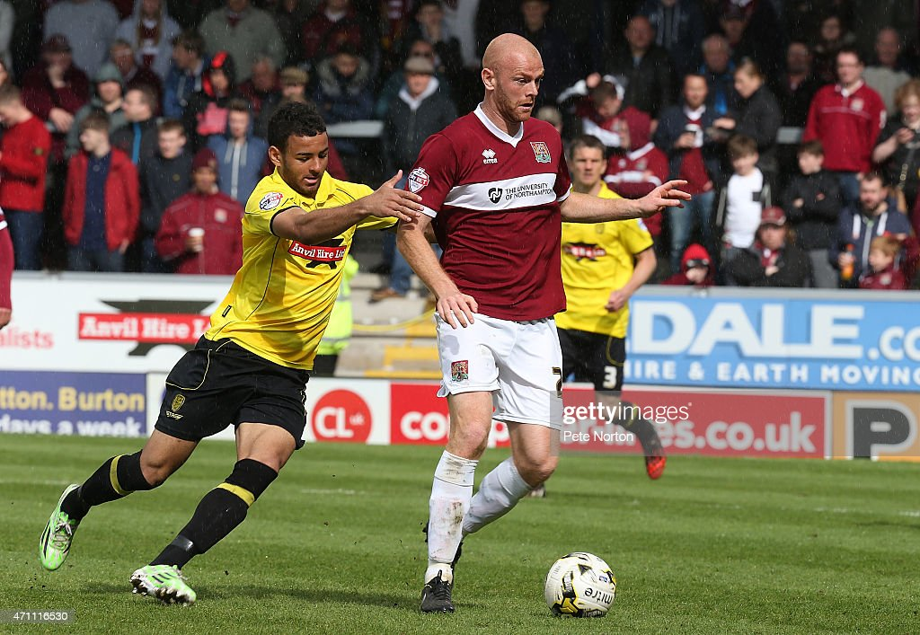 Jason Taylor of Northampton Town looks to control the ball under pressure from Kevin Stewart of Burton Albion during the Sky Bet League Two match between Burton Albion and Northampton Town at Pirelli Stadium on April 25, 2015 in Burton-upon-Trent, England.