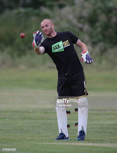 Jason Taylor of Northampton Town throws the ball while acting as wicketkeeper during a 20/20 Cricket Match between Bold Dragoon CC and Northampton...