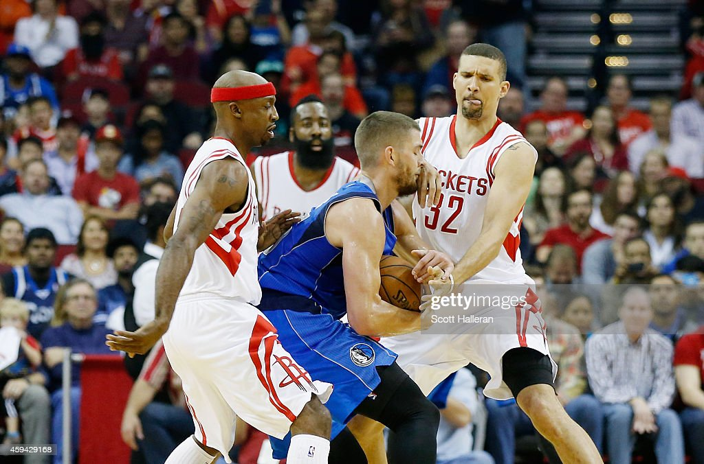 Jason Terry #31 and Francisco Garcia #32 of the Houston Rockets defend against Chandler Parsons #25 of the Dallas Mavericks during their game at the Toyota Center on November 22, 2014 in Houston, Texas.