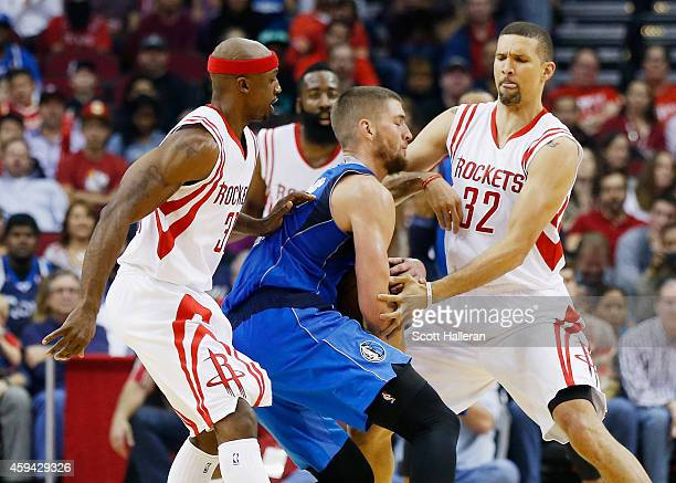 Jason Terry and Francisco Garcia of the Houston Rockets defend against Chandler Parsons of the Dallas Mavericks during their game at the Toyota...