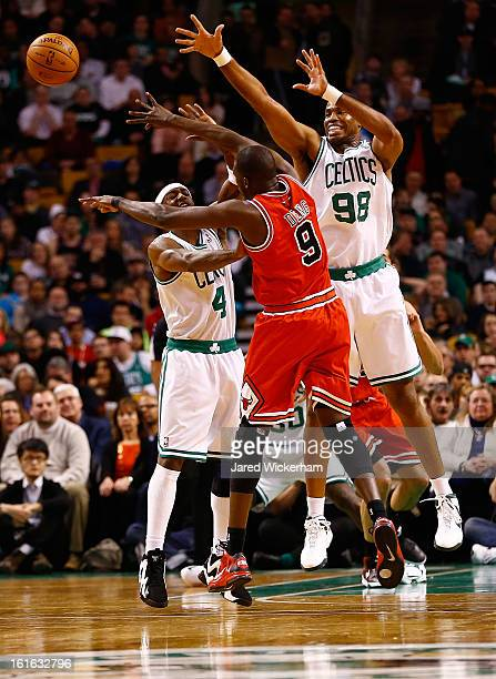 Jason Terry and Jason Collins of the Boston Celtics guard Luol Deng of the Chicago Bulls during the game on February 13, 2013 at TD Garden in Boston,...
