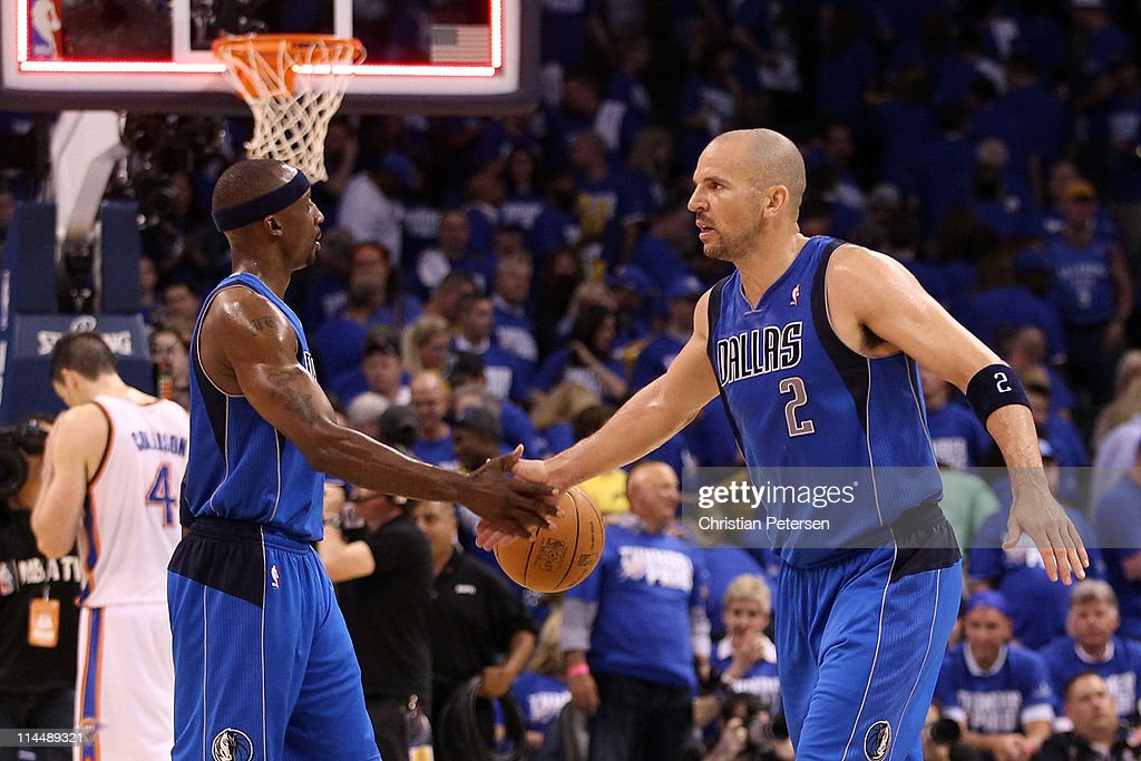 Jason Terry #31 and Jason Kidd #2 of the Dallas Mavericks celebrate the Mavericks 93-87 victory against the Oklahoma City Thunder in Game Three of the Western Conference Finals during the 2011 NBA Playoffs at Oklahoma City Arena on May 21, 2011 in Oklahoma City, Oklahoma.
