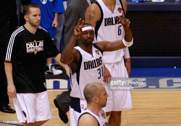 Jason Terry and Jose Juan Barea of the Dallas Mavericks celebrate after they won 86-83 against the Miami Heat in Game Four of the 2011 NBA Finals at...
