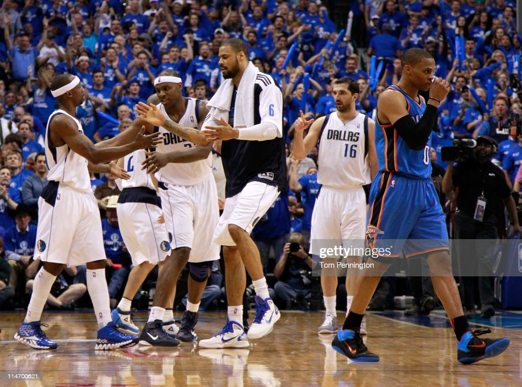 Jason Terry #31, Brendan Haywood #33 and Tyson Chandler #6 of the Dallas Mavericks react on the court in the third quarter as Russell Westbrook #0 of the Oklahoma City Thunder walks by in Game Five of the Western Conference Finals during the 2011 NBA Playoffs at American Airlines Center on May 25, 2011 in Dallas, Texas.
