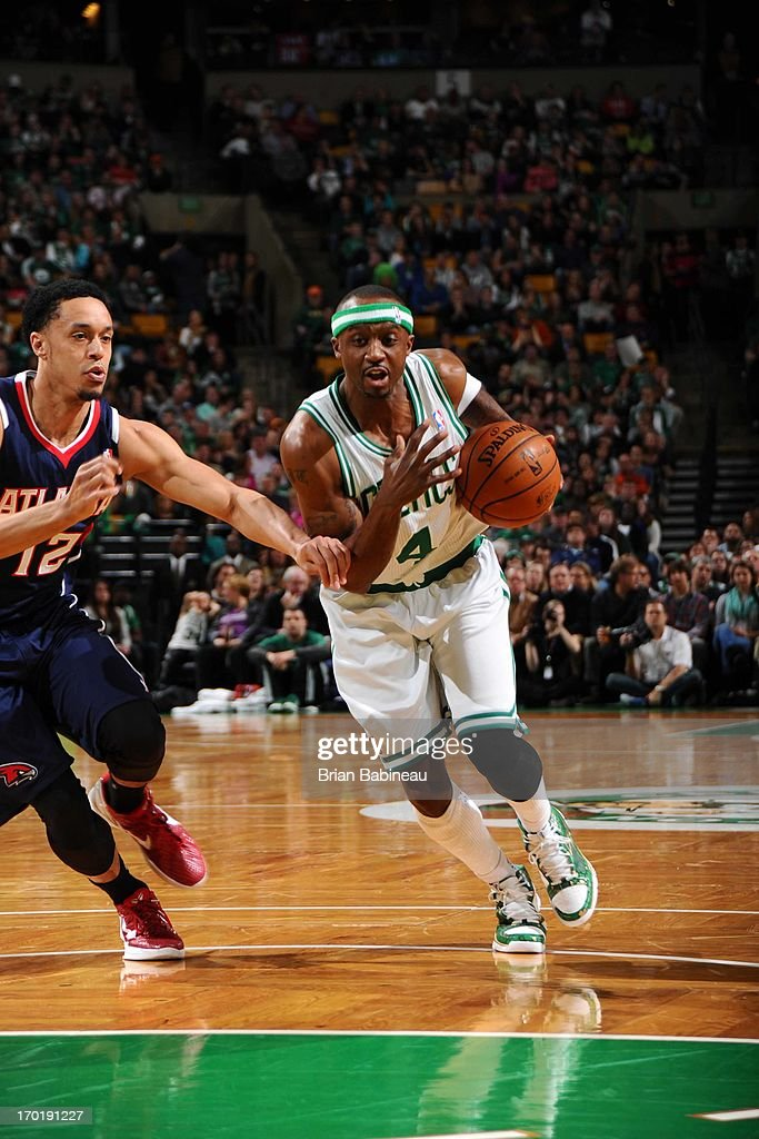 Jason Terry #4 of the Boston Celtics drives to the basket against John Jenkins #12 of the Atlanta Hawks on March 29, 2013 at the TD Garden in Boston, Massachusetts.