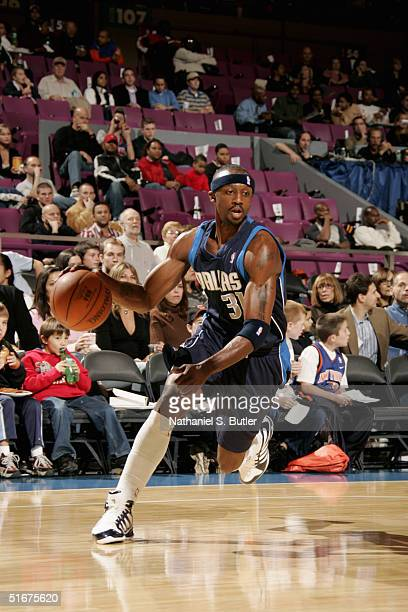 Jason Terry of the Dallas Mavericks against of the New York Knicks during the preseason game at the Madison Square Garden on October 24 2004 in New...
