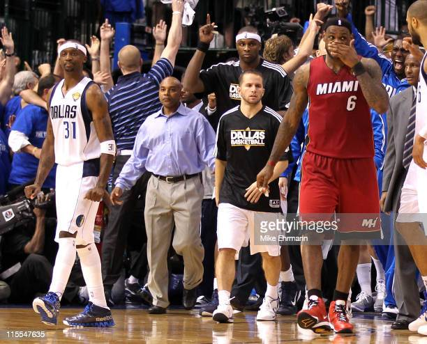 Jason Terry of the Dallas Mavericks and his teammates react to their 8683 win as LeBron James of the Miami Heat walks off the court in Game Four of...