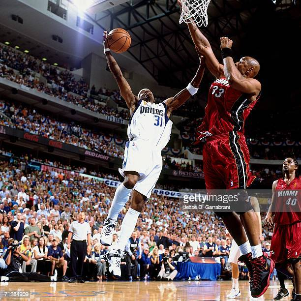 Jason Terry of the Dallas Mavericks attempts a layup against Alonzo Mourning of the Miami Heat during Game Six of the 2006 NBA Finals played June 20...