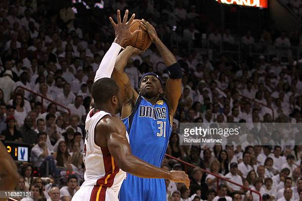 Jason Terry of the Dallas Mavericks attempts a shot against Dwyane Wade of the Miami Heat in Game Six of the 2011 NBA Finals at American Airlines...