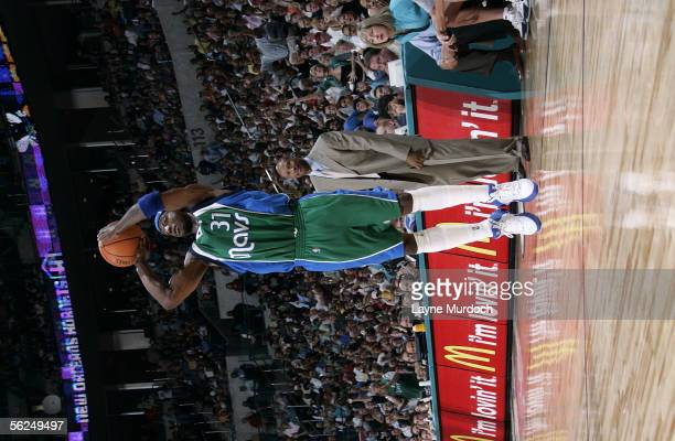 Jason Terry of the Dallas Mavericks attempts a shot against the New Orleans/Oklahoma City Hornets November 12, 2005 at the Ford Center in Oklahoma...