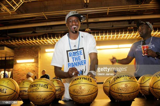Jason Terry of the Dallas Mavericks autographs special edition 'Champions' baskeballs during the Mavericks NBA Champion Victory Parade on June 16...