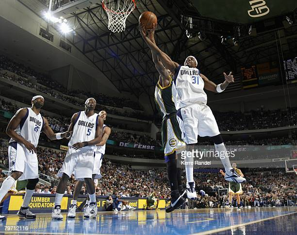 Jason Terry of the Dallas Mavericks battles for a rebound against Chris Wilcox of the Seattle SuperSonics during the game at American Airlines Center...