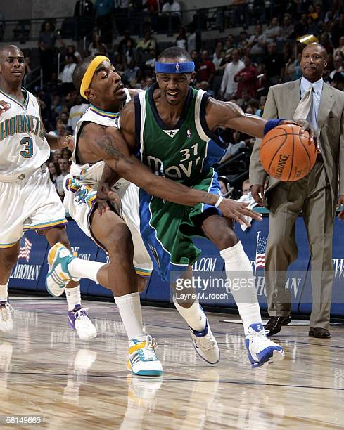 Jason Terry of the Dallas Mavericks dribbles around J.R. Smith of the New Orleans/Oklahoma City Hornets during a game at the Ford Center on November...