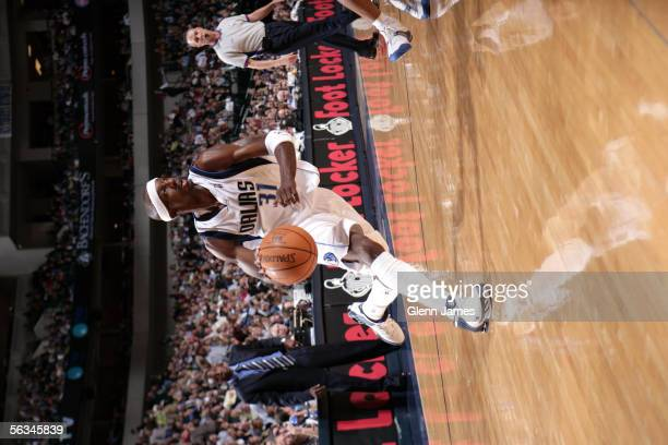 Jason Terry of the Dallas Mavericks drives upcourt during the game against the Detroit Pistons on November 19, 2005 at American Airlines Center in...