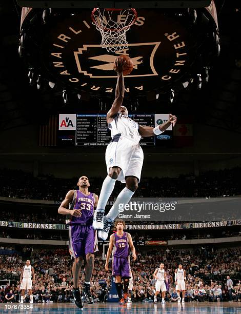 Jason Terry of the Dallas Mavericks gets out on the break for the finger roll against Grant Hill of the Phoenix Suns during a game on December 17...