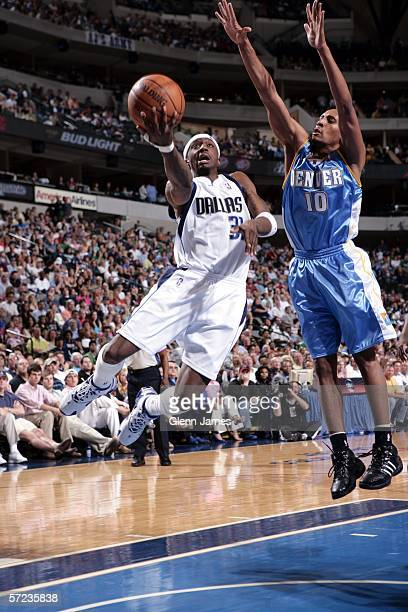 Jason Terry of the Dallas Mavericks goes in for a layup against Howard Eisley of the Denver Nuggets on April 2 2006 at American Airlines Center in...