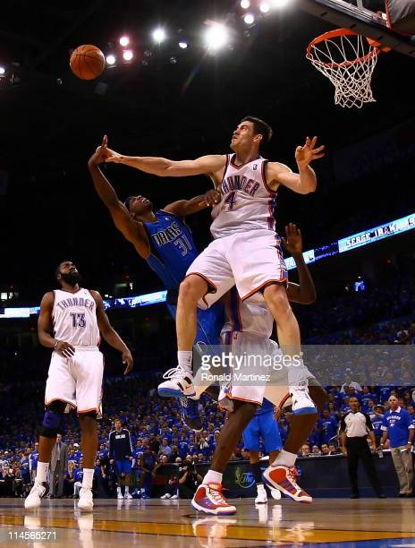 Jason Terry of the Dallas Mavericks goes up for a shot against Nick Collison of the Oklahoma City Thunder in the second half in Game Four of the...