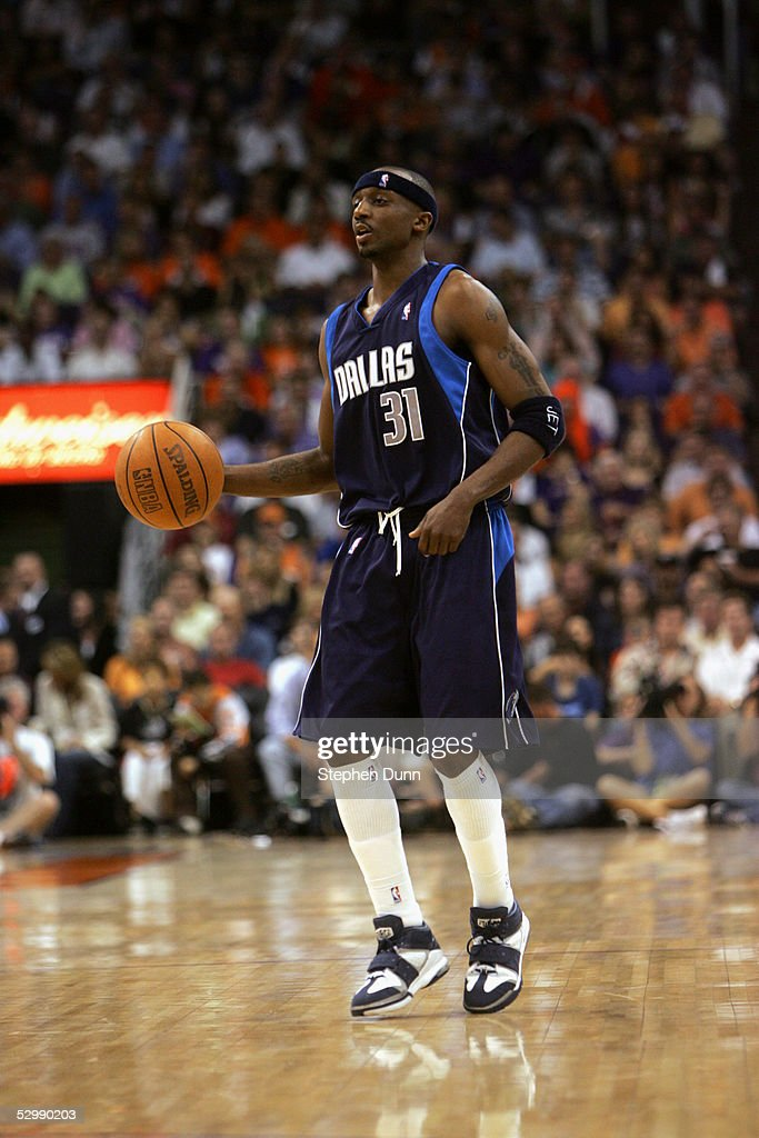 Jason Terry #31 of the Dallas Mavericks moves the ball against the Phoenix Suns in Game one of the Western Conference Semifinals during the 2005 NBA Playoffs at America West Arena on May 9, 2005 in Phoenix, Arizona. The Suns won 127-102.