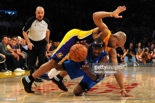 Jason Terry of the Dallas Mavericks moves the ball as Derek Fisher of the Los Angeles Lakers falls on top of him in the second half in Game Two of...