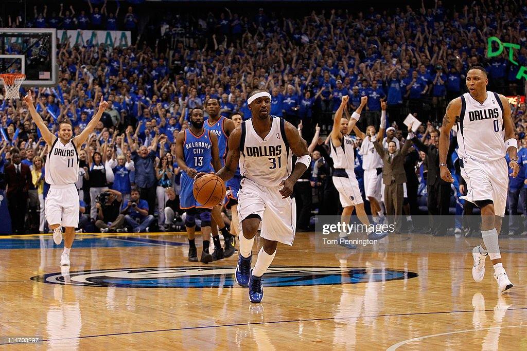 Jason Terry #31 of the Dallas Mavericks moves the ball down court as Jose Juan Barea #11 celebrates as the the Mavericks defeat the the Oklahoma City Thunder 100-96 in Game Five of the Western Conference Finals during the 2011 NBA Playoffs at American Airlines Center on May 25, 2011 in Dallas, Texas.