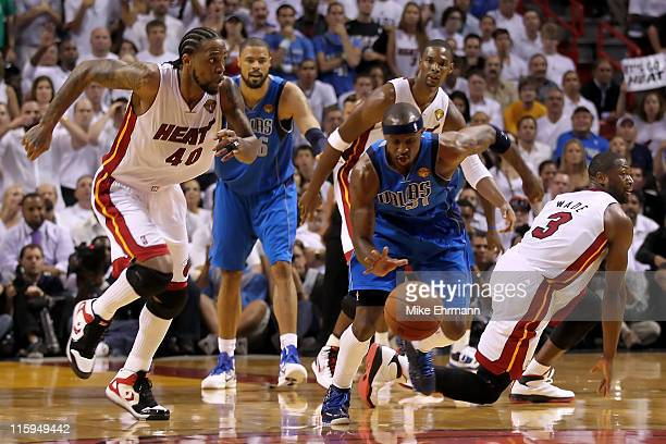Jason Terry of the Dallas Mavericks pushes the ball up court against Udonis Haslem Chris Bosh and Dwyane Wade of the Miami Heat in the second half of...