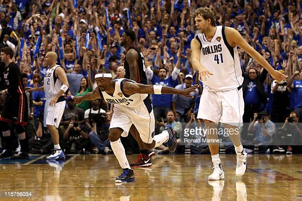 Jason Terry of the Dallas Mavericks reacts after he made a threepointer late in the fourth quarter alongside teammate Dirk Nowitzki while taking on...