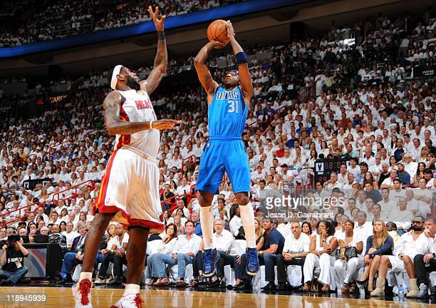 Jason Terry of the Dallas Mavericks shoots over LeBron James of the Miami Heat during Game Six of the 2011 NBA Finals on June 12 2011 at the American...