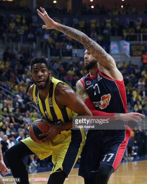 Jason Thompson #1 of Fenerbahce Dogus in action with Vincent Poirier #17 of Kirolbet Baskonia Vitoria Gasteiz during the Turkish Airlines Euroleague...