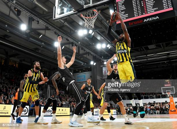 Jason Thompson of Fenerbahce Dogus in action against Aleksej Nikolic of Brose Bamberg during the Turkish Airlines Euroleague basketball match between...