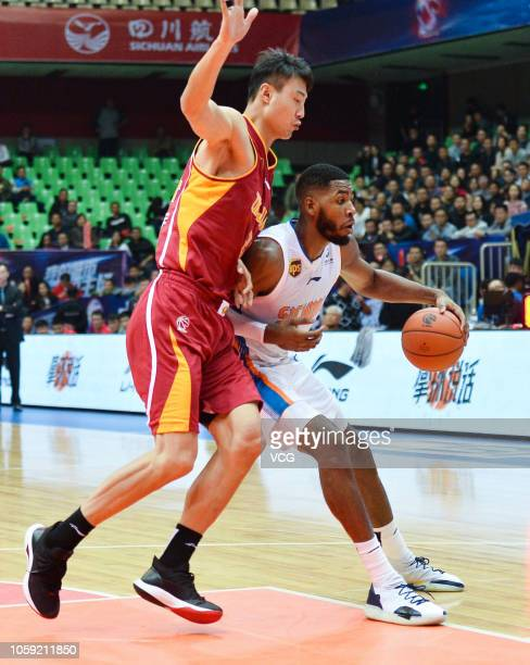Jason Thompson of Sichuan Blue Whales and Zhang Dayu of Zhejiang Golden Bulls compete for the ball during the 2018/2019 Chinese Basketball...