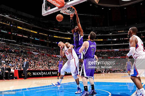 Jason Thompson of the Sacramento Kings dunks against Caron Butler of the Los Angeles Clippers at Staples Center on December 21 2012 in Los Angeles...