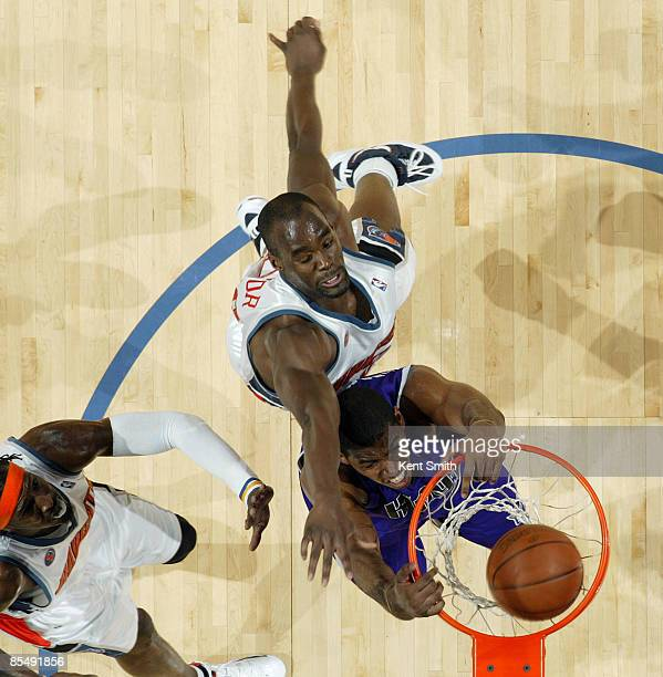 Jason Thompson of the Sacramento Kings dunks against Emeka Okafor of the Charlotte Bobcats on March 18 2009 at the Time Warner Cable Arena in...
