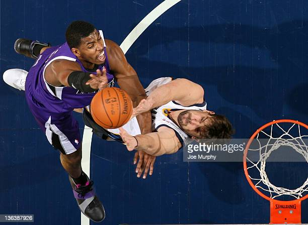 Jason Thompson of the Sacramento Kings fights for a rebound against Marc Gasol of the Memphis Grizzlies on January 3, 2012 at FedExForum in Memphis,...