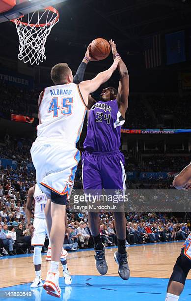 Jason Thompson of the Sacramento Kings goes to the basket against Cole Aldrich of the Oklahoma City Thunder during the game on April 13 2012 at the...