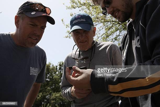 Jason Utas a 21 year of geology student at UC Berkeley shows a 75 grams fragment of a meteorite called CM chondrite to Doug Klotz and Paul Guttmann...