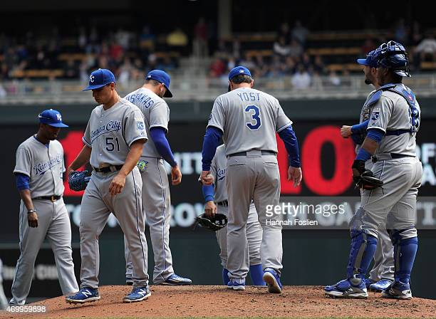 Jason Vargas of the Kansas City Royals walks off the mound after manager Ned Yost relieved him from the game against the Minnesota Twins during the...