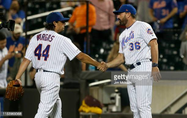 Jason Vargas of the New York Mets celebrates his shutout against the San Francisco Giants with manager Mickey Callaway at Citi Field on June 05 2019...