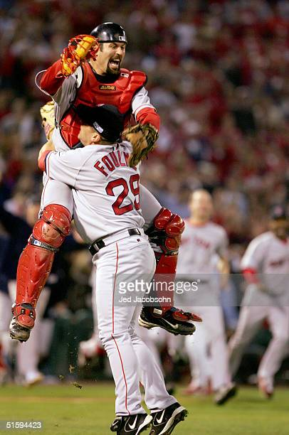 Jason Varitek and Keith Foulke of the Boston Red Sox celebrate after defeating the St Louis Cardinals 30 in game four of the World Series on October...