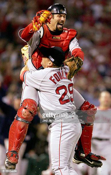 Jason Varitek and Keith Foulke of the Boston Red Sox celebrate after defeating the St. Louis Cardinals 3-0 in game four of the World Series on...