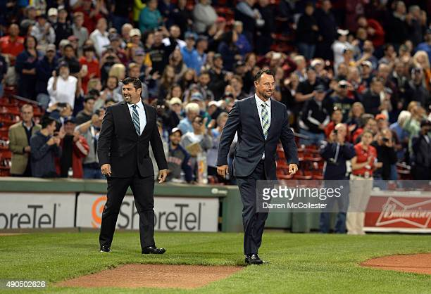 Jason Varitek and Tim Wakefield walk onto the field during a ceremony to honor David Ortiz's 500th home at Fenway Park prior to the matchup between...