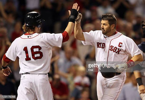 Jason Varitek of the Boston Red Sox celebrates his two run homer with teammate Josh Reddick in the eighth inning against the New York Yankees on...